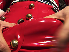 Sexy blonde shemale in red latex
