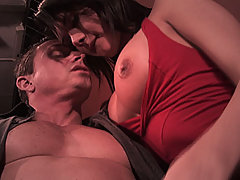 Brunette sucks cock and gets junk blasted on her in a crowded theatre
