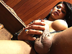 Shemale peels off her latex outfit and masturbates