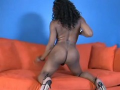 Round ass black busty tgirl on sofa